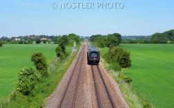 A train cutting through the fields
